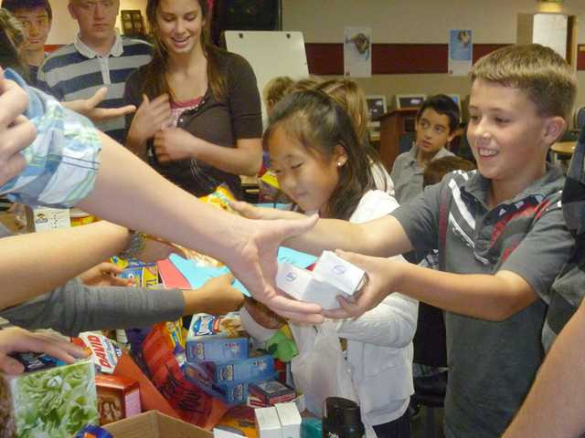 Students of Santa Clarita Christian School turn in items for Operation Gratitude to encourage armed service personnel overseas this Christmas.