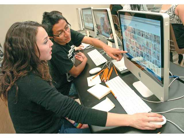 Golden Valley High School students Nicole Arango, 17, left, and Aurelio Garcia, 17, discuss promotional T-shirt designs for a virtual business, Acoustic Cakes and Apparel, during a Regional Occupation Program class.