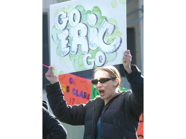Kerry McGuire cheers on her first-grade son Eric as he passes by.