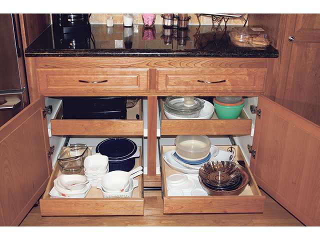 Cabinet accessories can include handy rollout trays that make finding and reaching stored items more convenient.