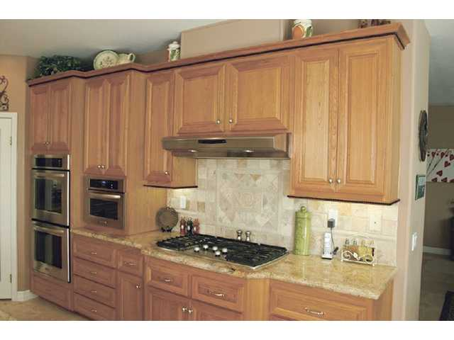 A natural cherry reface to kitchen cabinets in a Saugus home.