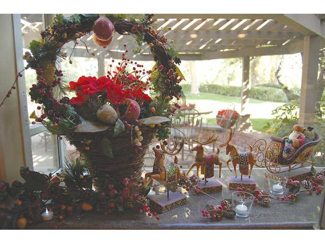 Bountiful garlands and playful reindeer rest on the windowsill at the Hawkins' home in Newhall.