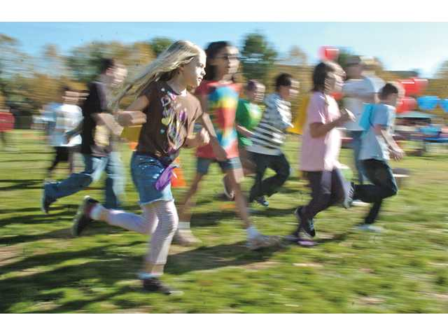 Third-graders run a lap during a fundraiser jog-a-thon at Santa Clarita Elementary School in Saugus on Nov. 18.