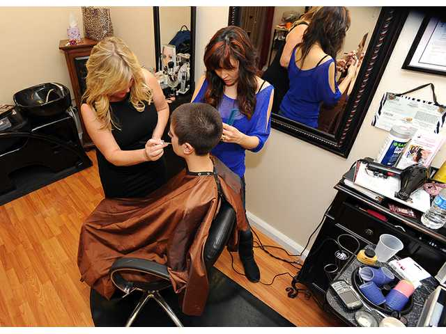 Co-owners Sally Van Swearingen and Catherine Weber work on a client at the AList Hair and Makeup Studio in Newhall.
