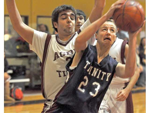Prep basketball: Trinity drops inaugural game