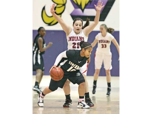 Hart forward Christina Falcone (21) defends Stockdale's Alyssa Shannon (10) on Saturday at Valencia High School. The Indians fell in the third-place game of the Valencia High-Five Classic.