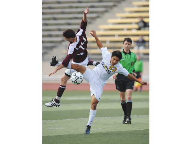 COC midfielder Carlos Hernandez (23) vies for the ball against Mt. San Antonio College's Javier Castro (14) during the CCCAA State Championship game on Sunday at Cougar Stadium.