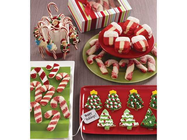 Candy canes, peppermint ribbons and evergreen treats offer a minty mix of holiday cookies, while Santa Claus and Frosty Friends Candy Cane Molds can dress up holiday treats.