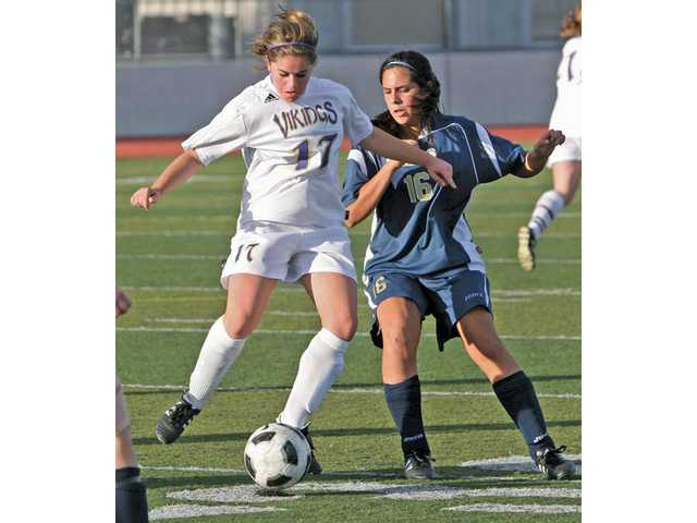 Valencia's Rebecca Harrison, left, steals the ball from Yucaipa's Danica Requejo on Friday at Valencia High.