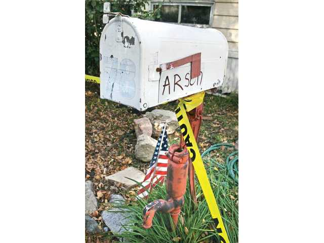 "A magnetic sign that Tony Follett attached his mailbox displays the word ""arson"" to advertise the suspected cause of the fire at his mobile home in the Mulberry Mobile Home Park in Newhall on Thursday."