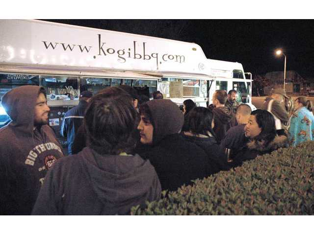A line of local residents formed long before the Kogi BBQ truck pulled onto Chestnut Street in Newhall on Wednesday night