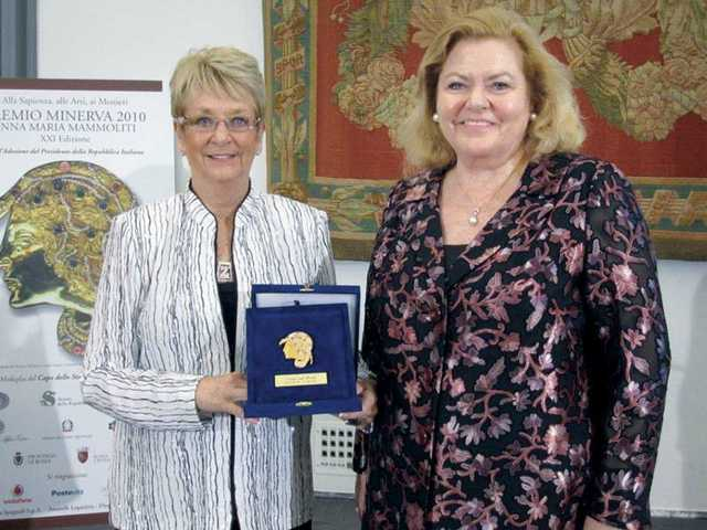 Santa Clarita Valley resident Dianne Curtis, left, president of Zonta International and a member of the Zonta Club of SCV, is presented the Minerva Award by Simone Ovart, an Italian Zontian.