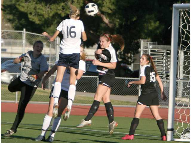 Saugus defender Serena Smith Banas (16) heads the ball in for the Centurion' only goal of the game over Glendora defender Ellie Jaques (11) Monday at Saugus High.