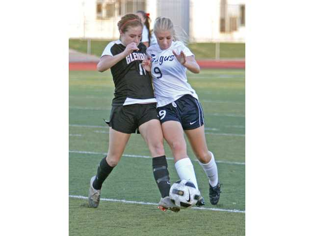 Glendora defender Ellie Jaques, left, and Saugus midfielder Jessica Weber fight for the ball during a game at Saugus High School on Monday. The game finished in a 1-1 tie.