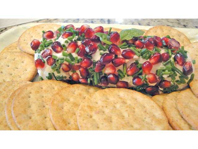 Pomegranate chive goat cheese log.