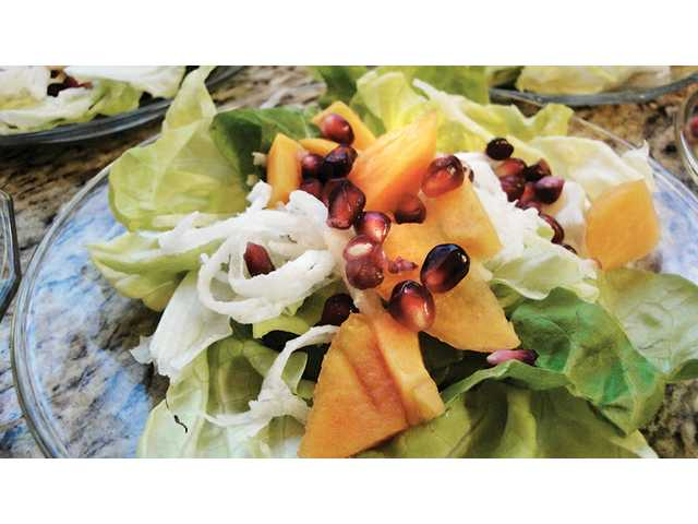 Persimmon, jicama and arils salad on butter lettuce with pomegranate shallot vinaigrette.