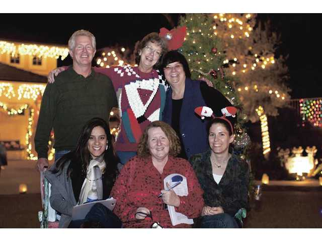 The Signal's Holiday Light Tour judges. Back row, left to right, Jim Walker, Lila Littlejohn and Stephanie Weiss. Front row, left to right, Melissa Gasca, Michele Buttelman and Natalie Everett.