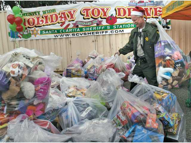 The estimated 3,500 toys were donated at collection boxes located at schools and businesses throughout the Santa Clarita Valley, and will be presented to needy families in the area for the holidays by SCV Food Pantry.