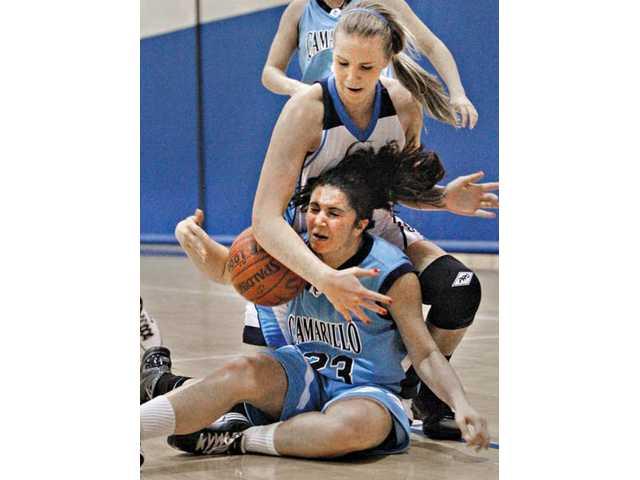 Saugus' Kayla Hiller, top, battles Camarillo's Micaela Pericone-Kapp for the ball on Tuesday at Saugus High School.
