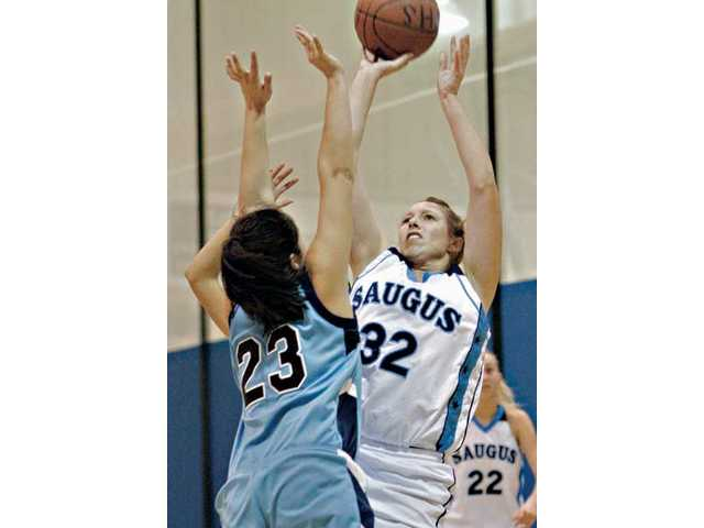 Saugus' Crystal Makous (32) puts up a shot over Camarillo's Micaela Pericone-Kapp during the first half on Tuesday at Saugus High School. The Centurions won 57-51.