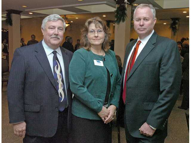 From left, Randy Moberg, outgoing chairman of the Valley Industrial Association of Santa Clarita; Kathy Norris, VIA's president and CEO; and Tim Burkhart, incoming chairman of VIA, pose at the association's luncheon at Valencia Country Club in Valencia on Tuesday. (Below)