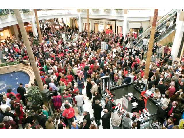 About 600 singers from local churches and schools held an impromptu Christmas concert at Westfield Valencia Town Center in Valencia on Sunday.