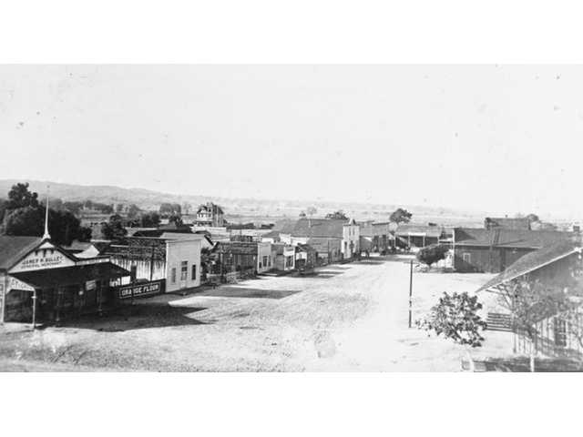 Saloons and general stores dominated the scene along Old Newhall's Main Street in this picture from the 1890s. Two general stores, a judge's residence and two saloons occupied the street during that decade. Efforts to improve downtown Newhall date as far back as 1921.