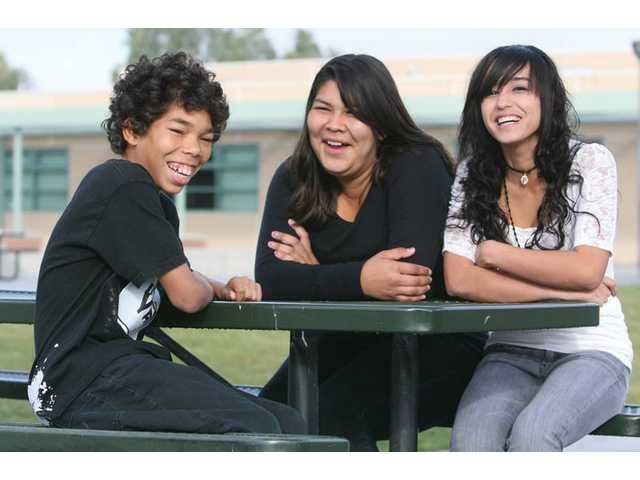 When Justin Gittens, 13, left, was choking at La Mesa Junior High School in Canyon Country earlier in the month, Claudia Ortiz, 14, center, and Jenny Escamilla, 14, took him to the office.