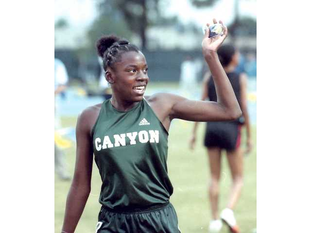 Alysia Johnson, seen here as a Canyon runner in 2001, is recognized by many as one of the great athletes in this valley's history.