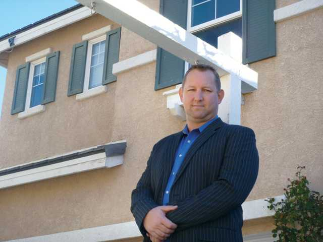 Tim Blankenship, owner of the Santa Clarita Short Sale Center, stands in front of one of the many properties he has listed for sale, where he is in negotiation with lenders to approve a short sale. The short-sale option rescues homeowners in grim financial straits and minimizes damage to their credit.