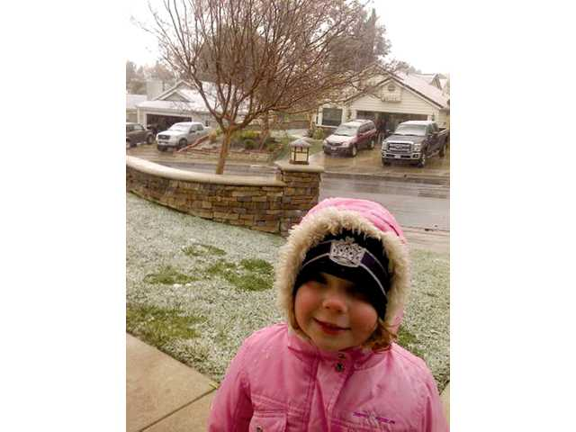 Krista Viereck, 4, enjoys the snow in Castaic. The SCV was forecast for rain but the snow level dropped farther than expected, giving locals some snow.