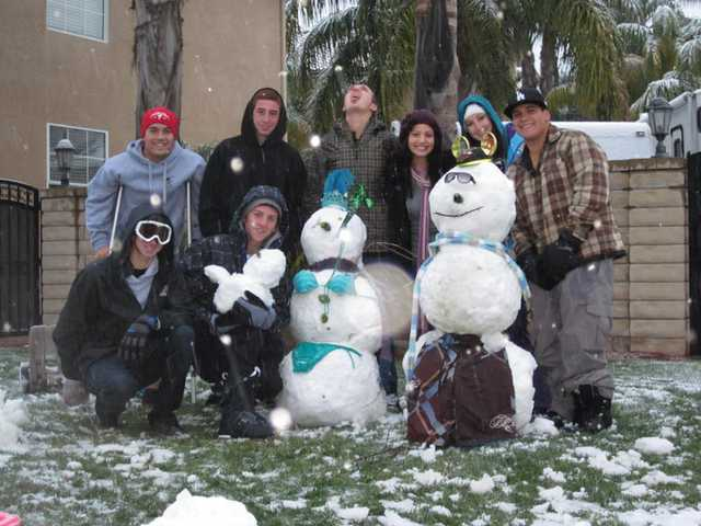 Saugus residents stand by a snowman and snowwoman that are more suited for typical Southern California weather. Top row from, left to right: Chad Gittisarn, Dillon Villalobos, Brett Piper, Christina Ratkay, Parisse Villalobos and Ruben Talamantez. Bottom row: Troy Anaya and Tyler Ybarra.