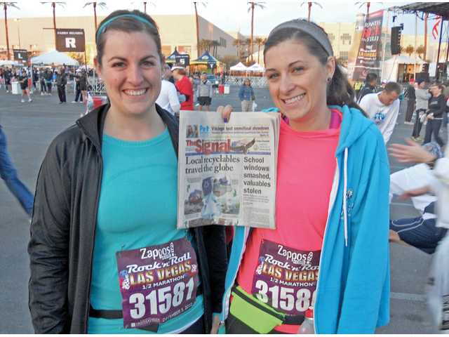 Katy Casellini, left, and Vickie Wagenaar, of Canyon Country, can check another thing off their bucket list after completing the Rock 'n' Roll Half Marathon in Las Vegas, Nev., on Dec. 5, 2010. The marathon and half-marathon featured live entertainment along the race route, including music, cheerleader and Vegas-inspired fanfare.