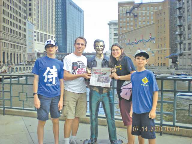 "The Weilands visited Milwaukee, Wis., in July. The family found a bronze statue of Arthur Fonzarelli, on the Milwaukee riverfront, a tribute to the show ""Happy Days,"" which was set in Milwaukee. From left, Greg, Jim, Terri and Matt Weiland. The ""Bronze Fonz"" is at center, along with the Weiland's issue of The Signal."