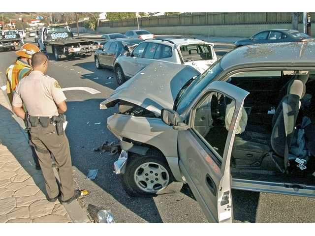 Los Angeles County Sheriff's deputies and firefighters respond to a crash in Saugus on Monday. Three vehicles collided about 3 p.m. Monday on Bouquet Canyon Road west of Seco Canyon Road, Los Angeles County Fire Department officials said.