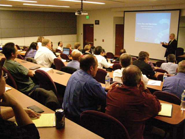 Attendees watch a presentation at one of the many seminars and training classes sponsored by the College of the Canyons Economic Development Department and Small Business Development Center to match employers to employees and provide training opportunities.