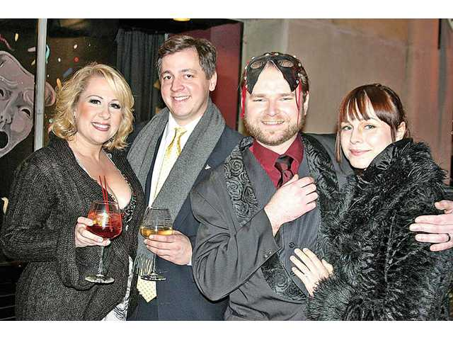 From left to right, Erin Rivlin and her beau Ransom Boynton with Mikee and Amber Schwinn toast to another bonne année at the fifth annual Carnivale di Venezia at the REP East Playhouse on Dec. 31.
