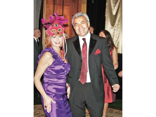 Carnivale first-timers Sara Viola and Gino Cuellar danced the night away. The event featured food by RSVP Catering, a midnight champagne toast and dancing to music that spanned genres from oldies to 1980s pop. The REP will open its seventh season on Main Street in Newhall on Jan. 21.