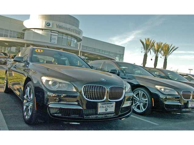 A 2011 740 Li sedan sits on the lot at Valencia BMW on the Valencia Auto Row. U.S. sales increased nearly 17 percent in December compared to vehicles sold in the same month a year ago, according to the U.S. BMW Group, which reported BMW brand sales were up 12 percent overall in 2010.