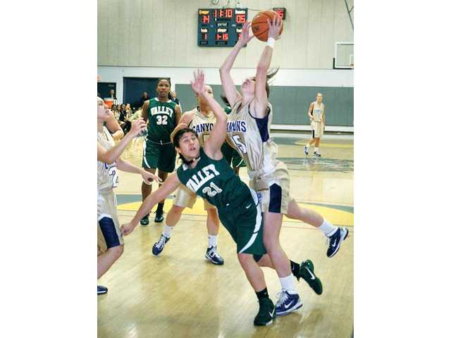 College of the Canyons' Jenny Lentz, right, grabs a rebound against Los Angeles Valley College's Alejandra Gallardo (21) on Saturday at College of the Canyons.