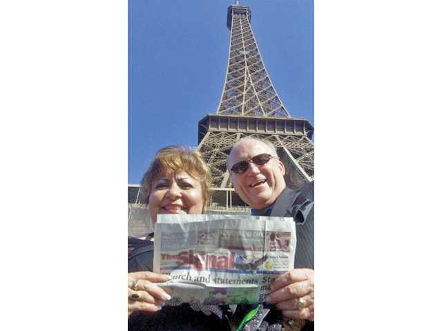 Jeannie and B.J. Atkins stand in front of the Eiffel Tower in Paris, France during their trip in May of 2010. Just after this photo was taken, the couple boarded the Eiffel Tower's elevator to have dinner on the first level.