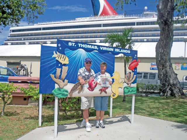 Harry and Georgene Christensen, of Valencia, pose at a photo spot outside their cruise ship terminal for the Carnival Freedom cruise ship. The Christensens visited the Eastern Caribbean in September 2010 with friends Willy and MaryJane Williams, of Virginia Beach, Va.