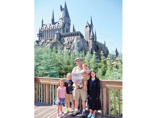 The Dunne family is seen in front of Hogwarts castle while visited the Wizarding World of Harry Potter at the Universal Orlando Resort in Orlando, Florida during a fall break from school. From left: Francesca Dunne, 5; Charlotte Dunne, 7; Christopher Dunne; Alexander Dunne, 2; Julia Dunne, 10. Mirissa Dunne took the photo.