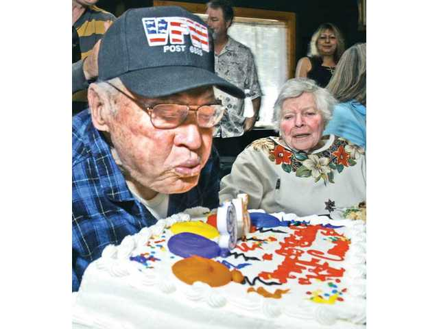 "L. Archie ""Kit"" Carson, left, and his wife of 65 years, Mildred, join with friends and family to celebrate his 95th birthday at the VFW 6885 in Canyon Country in Jan. 15."