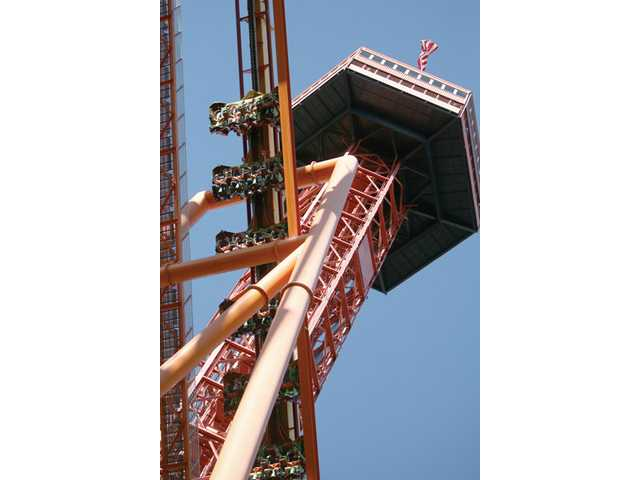 Riders on roller coaster Tatsu climb a track near the Sky Tower at Six Flags Magic Mountain in Valencia on Monday.