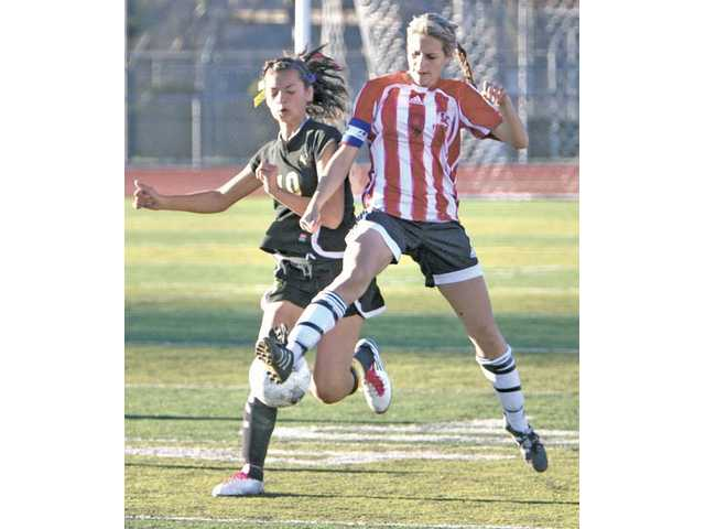 Katie Trevino (9), right, of Hart High School steals the ball from Rachel Hoeft (10) of Golden Valley at Hart in Newhall on Friday. Hart won 2-0 over Golden Valley.