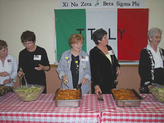 Members of Xi Nu Zeta prepare to dish up their special lasagna at the 2010 fundraiser.