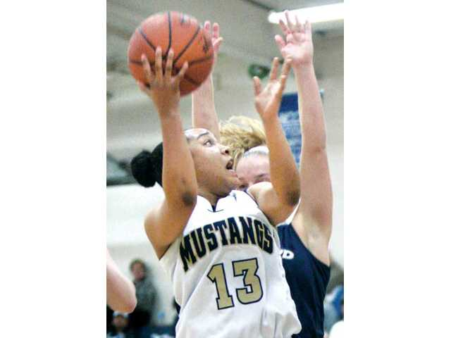 TMC point guard Erica Inge (13) tries to find room to shoot against Vanguard's Danielle Arriola Saturday at TMC.