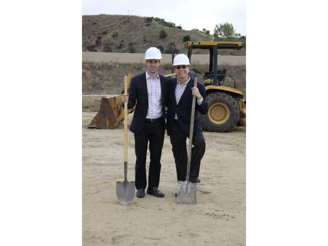 From left to right, developers Weston and Jonathan Cookler shovel dirt at the groundbreaking of their new Avalon Business Center in the Valencia Commerce Center. Their plan is to create four free-standing industrial buildings that will be aesthetically pleasing, as well as good for the environment, energy and employees, saving tenants money.
