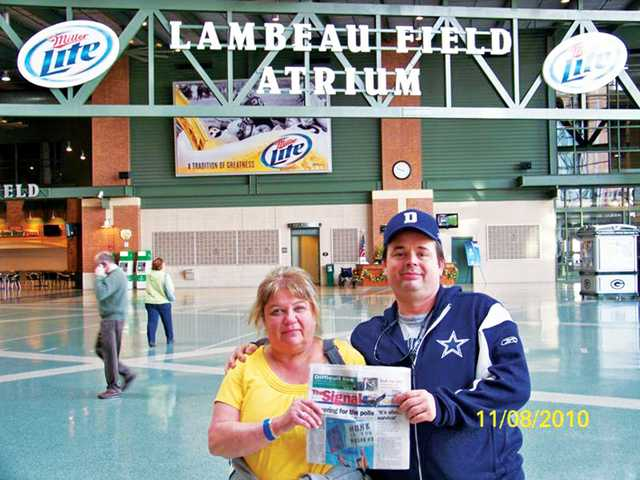 Brenda and Jonathan Gritzner pose for a photo outside Lambeau Field in Green Bay, Wis., before the Green Bay Packers and Dallas Cowboys football game on Nov. 8. Brenda is a Packers fan, and Jonathan is a Cowboys fan. The Packers beat the Cowboys 45-7.